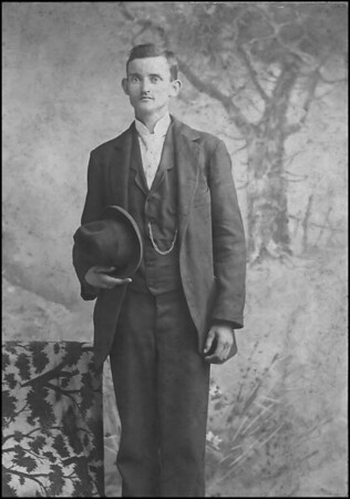 """Walter Diggs Gean<br /> March 23, 1876 - June 23, 1955<br /> <br /> The original is very faded, this image is an attempt at restoration.<br /> <br /> Handwritten on Back, Legible:<br /> """"Walter Gean age 18 yrs.""""<br /> <br /> Illegible, some what:<br /> """"Walter D. Gean""""<br /> """"P.O. La(obscured""""<br /> """"1 1/2 Mi from a (obscured) road (obscured)""""<br /> """"Shilo (?) Ch.""""<br /> <br /> """"B.C. 1 \98 (as in 'one dollar and 98 cents')  Nov.15,1903""""<br /> """"a 367""""<br /> <br /> Cropped from this image is printers logo across bottom:<br /> """"J. D(?). Huffman & Son, Tupelo, Miss."""""""