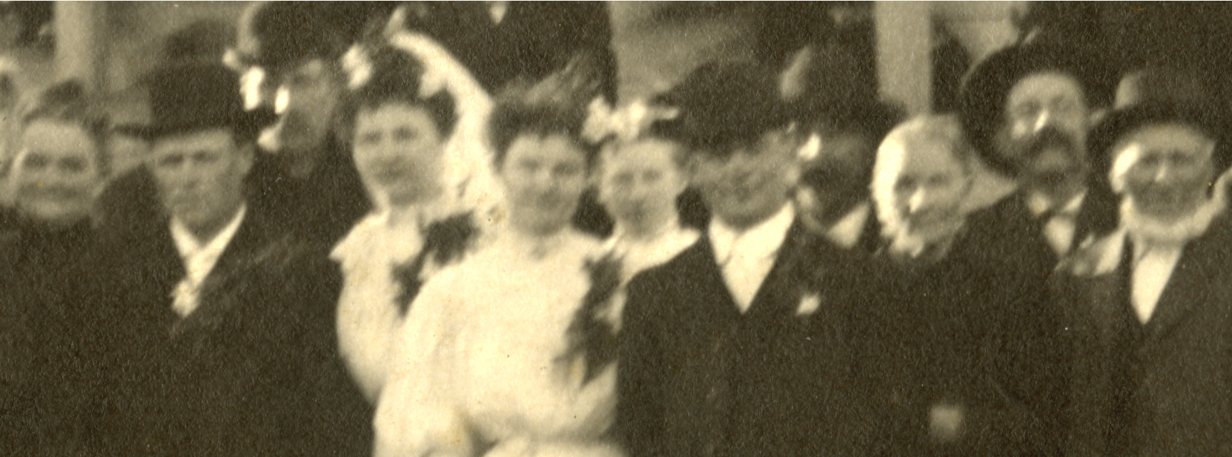 "A close up of my grandparents' wedding celebration, April 9, 1907.  Far left is Mary Burger Beckman, my great-grandmother.  The front row (l to r) is then my Grandfather, Anton Boeckenstedt, my grandmother, Agnes Beckman Boeckenstedt, my grandmother's sister Maime Beckman, unidentified girl, John ""Pinoak"" Boeckenstedt(Anton's brother),my great great grandmother Anna Marie Wiechmann Boeckenstedt , unidentified man, and my great grandfather Clemens Boeckenstedt, b. 1934 in Steinfeld, Germany."