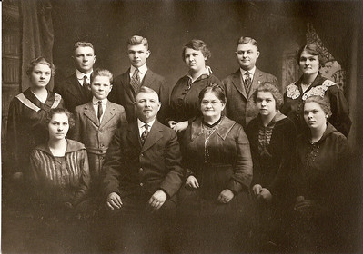 Another image of Bernard and Mary Burger Beckman's family.  Mary came to the US from Germany as a little girl, but her family lost everything in the Chicago fire.  Back row, r to l: Mayme, Charles, Agnes, Ralph, Albert, Emma.  Front row: Nellie, Rose, Mary, Bernard, Bernard, Jr,. Elsie
