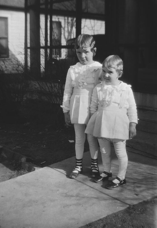 Helen and Dorothy Glines ca. 1929.  Was it Easter?  The yard foliage is dead so it may be late winter but the dresses look light so it makes me think Easter.