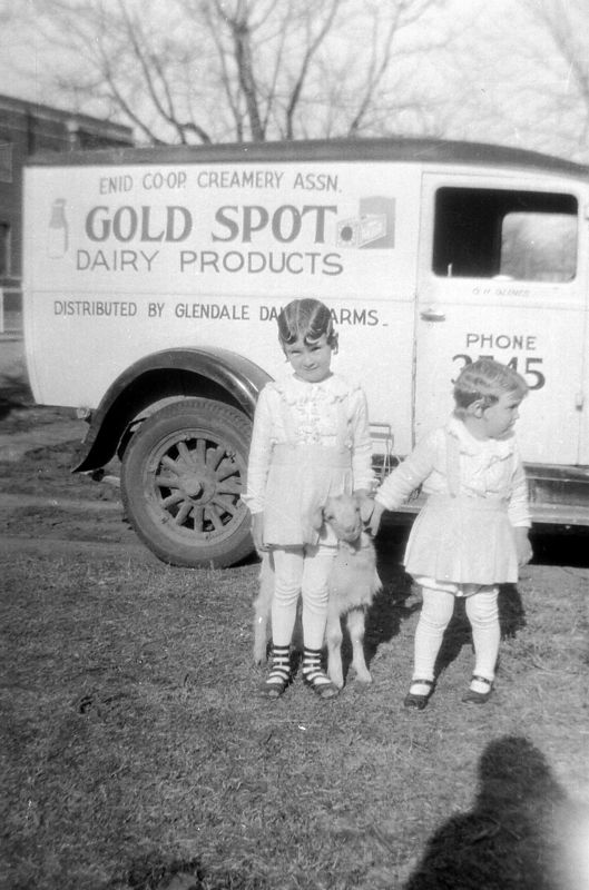 This is Helen and Dot Glines.  If you look closely, you will see the name G.H. Glines on the door of the truck.  When I looked at the negative, I thought Helen was holding a large doll.  I was quite surprised to see the goat in the photo. :)