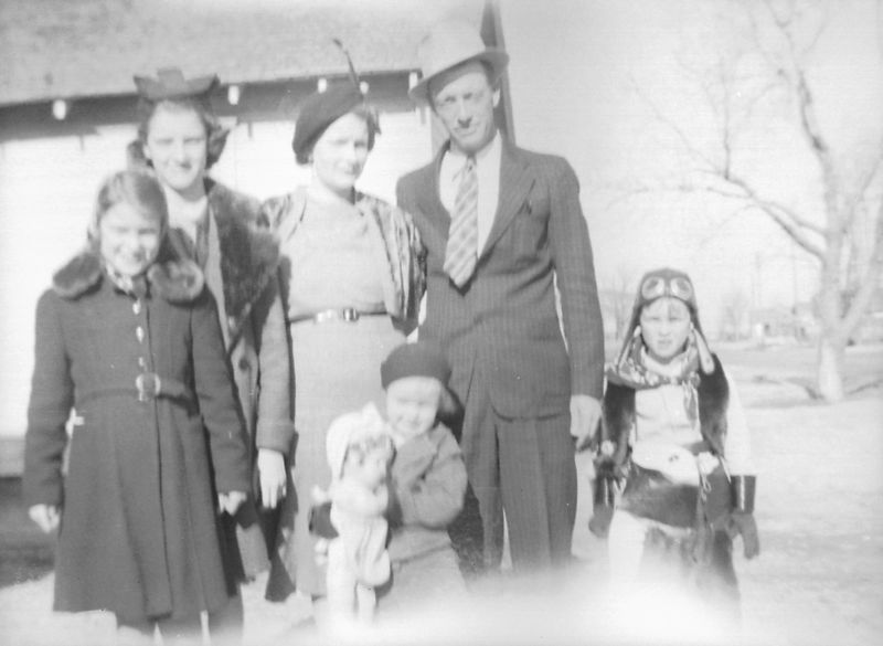 L to R:  Dorothy, Helen, Ada, baby Lois, George and Herb.  This was the best scan I could get of the negative.  They were all dressed up, may be Christmas?  ca. 1936 or 37