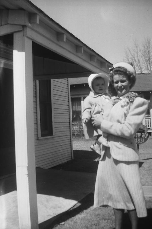 Unknown baby with Ada Glines, maybe it is baby Judy Dugan in front of 808 S. Independence.