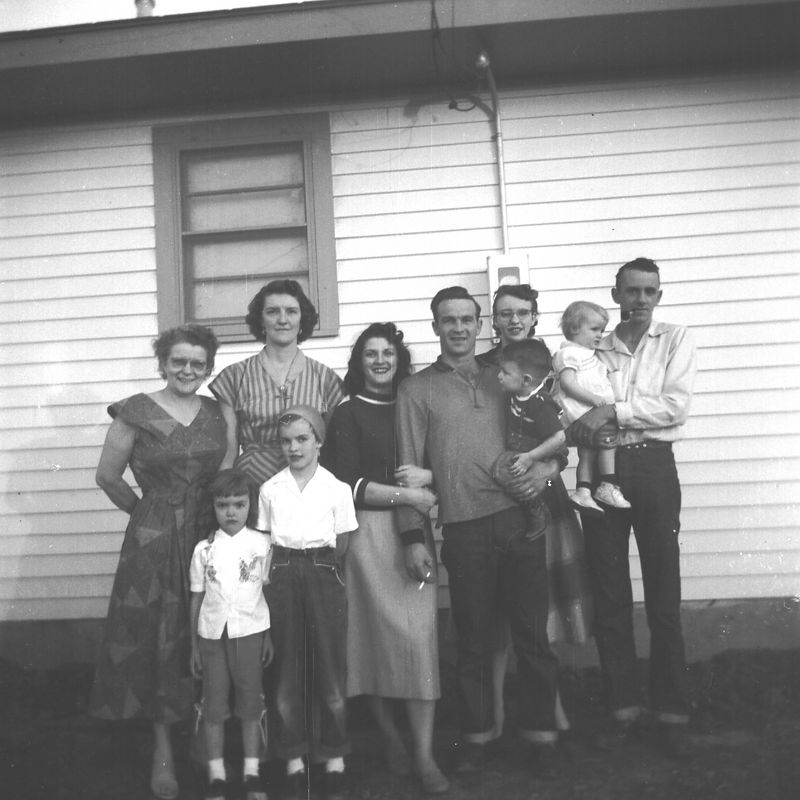 The Whole Gang  L to R:  Ada Glines, Joyce, Helen and Judy Dugan, Phylis, Herb and Mike Glines, Lois, Jana and LE Clark.   Dorothy was in Guam?