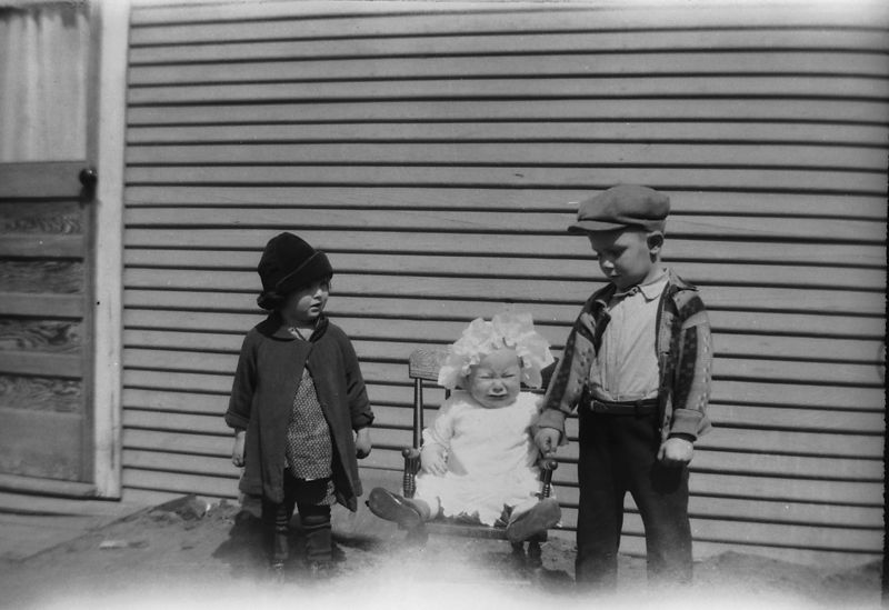Goldie Gladys Glines, baby Helen Glines and Ernest Glines.  Looks like Helen didn't want her hand held.