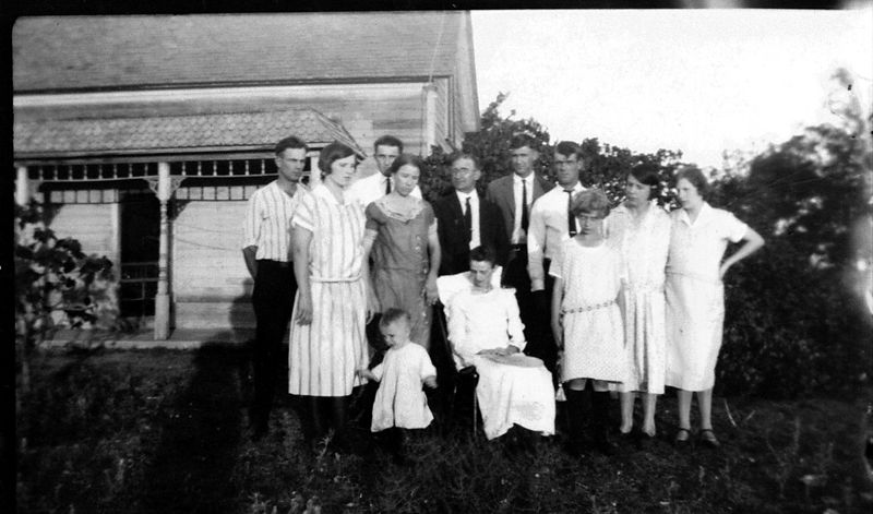 This is the Griffith Clan.  I am just guessing here...L to R: ?? (could be Basil Thomas), Ola, Lorin, Elsie, baby Joseph Earl Thomas (Elsie's boy), Joseph Griffith (patriarch), Francis Ann (matriarch), Harry Lee, Earnest Culver, Ola Mary (Ola's daughter), Francis, and Ada.  Since Ada is pregnant, I'm guessing this picture is taken ca. 1925.
