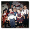 """Kids At Christmas - 1964""<br /> Christmas day in Uncle Cliff's basement was a tradition. (Back row) Kevin Hall;<br /> (Middle row) Donna, Darlene, Mark & Michael Hall;<br /> (Front row - standing) Harry, Linda & Guy Hall."