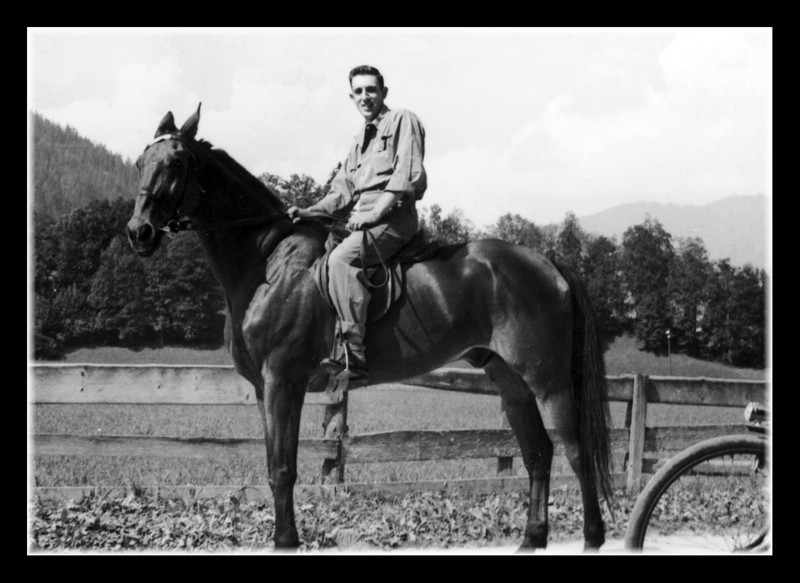 """Ride 'Em Cowboy!""<br /> Clifford ""Pete"" Hall posing on a horse in Berchtesgaden, Germany, 1951."