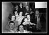 """""""On The Stairs""""<br />  All lined up on the stairs inside Memere & Pepere's house are:<br /> Front row l-r; Wilfred & Rose(Couture) Hall<br /> 2nd row l-r; Agnes (Simard) Couture, Hannah (Norberg) Couture holding Judy Ann Couture.<br /> 3rd row l-r; Patricia Hall, Odna (Couture) Marchand, Roger (Butch) Hall<br /> Top row l-r; Telesphore (Lucien) Couture, Ruth Hall, Honore (Henry) Marchand"""