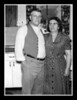 """Pepere & Memere""<br /> Wilfred & Rose (Couture) Hall in their kitchen, Thanksgiving Day, 1954."