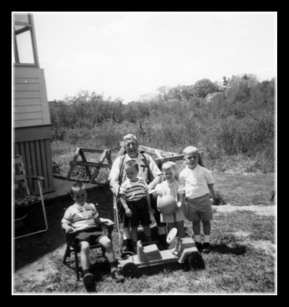 Pepere Wilfred Hall and a few of the grandchildren. (l-r); Mark, Bruce, unknown & Guy Richard Hall. Anyone know who the unknown cousin is?