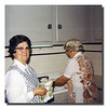Mary Jeanne Couture (l), & Rose (Couture) Hall (r) doing the dishes. That's right, Aunt Mary Jeanne is doing dishes! That's almost as rare as Cheryl Ann Hall doing dishes!