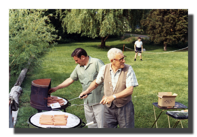 """The Iron Chefs""<br /> Donald H. (l) & Wilfred J. Hall (r) manning the grills at one of the frequent Hall cookouts, May 30, 1970."