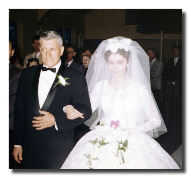 """""""Proud Father""""<br /> Wilfred Hall walks his daughter, Patricia, down the aisle, May 30, 1961."""