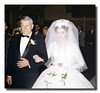 """Proud Father""<br /> Wilfred Hall walks his daughter, Patricia, down the aisle, May 30, 1961."