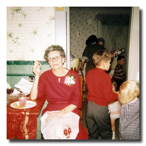 """Mon Tante Lill""<br /> Lillian (Hall) St. George at Wilfred & Rose Hall's house on christmas day. I can't believe she has a cigarette going inside the house! That's what the porch was for. Remember the thick cloud of smoke out there when everyone was out there at the same time?"