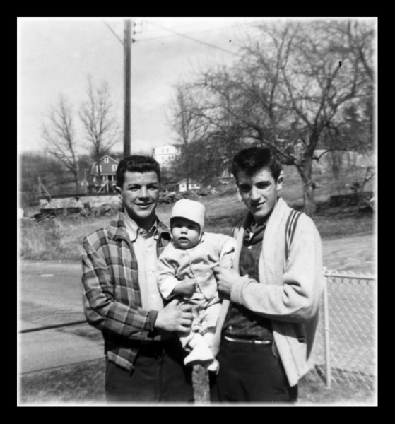 """Roger Martineau (l) & Roger """"Butch"""" Hall (r) with unknown baby. Anybody know who the baby is?"""