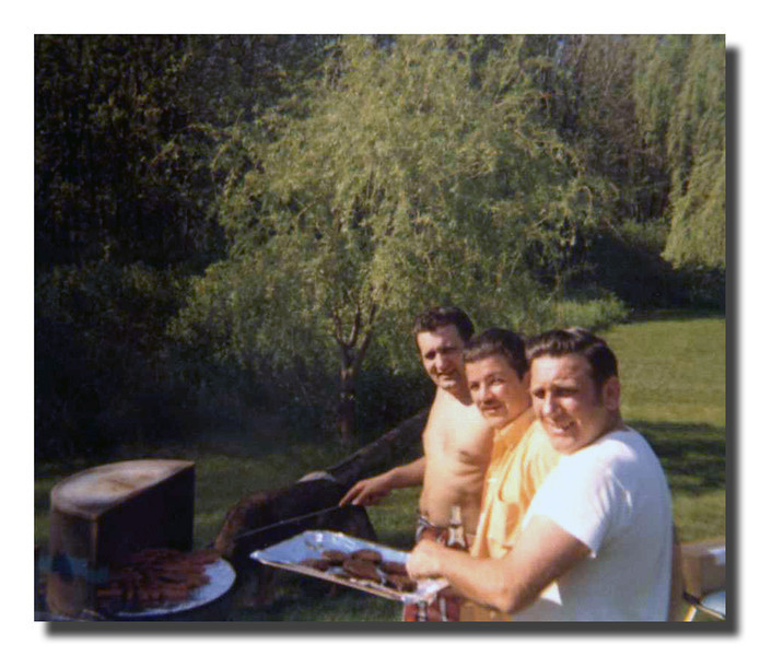 """Watch Out Food Network!""<br /> Manning the grill at one of the Hall cookouts at Memere & Pepere's house (front to rear), Donald Hall, Roger Martineau & Wilfred (Jr) Hall."