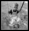 """Looking Sad""<br /> Michael Hall having fun on the swing? I don't look like I'm enjoying myself. 1959"