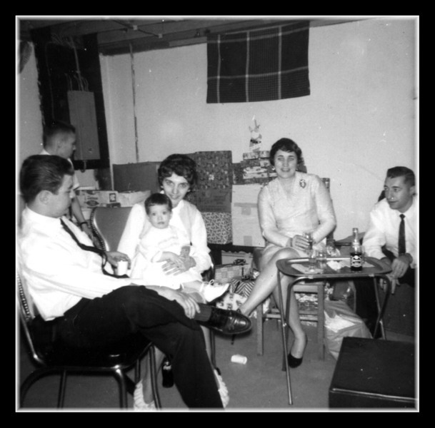 """""""Christmas Gathering""""<br /> Christmas day 1963 at Uncle Cliff's house. (l-r); Roger & Patricia (Hall) Martineau with daughter Susan on her lap, Ruth (Hall) & Raymond Asselin."""