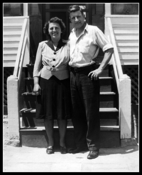 """Memere & Pepere""<br /> Rose (Couture) & Wilfred Hall in front of their home."
