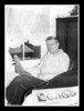 """The Reading Room""<br /> Pepere Wilfred Hall enjoying the paper in his chair in his bedroom. Remember the small bureau with the candy draw? You had to shake the hand that shooked the hand to get a piece!"