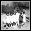 """First Communion Day""<br /> Gail, Darlene, Cheryl Ann, Kevin, Denis (looking for something he lost!) & Joann Hall at Uncle Cliff's house on Kevin's First Communion day, 1962. Aunt Doris' dog Suzette is posing with them. Uncle Donald's house is in the back round, under construction."