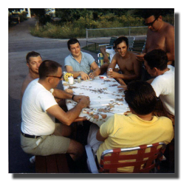 """""""The Big Game""""<br /> Besides the badminton matches, there was always a card game outside at the cookouts at Memere & Pepere Hall's house. (l-r in circle); Clifford (Pete) Hall, Raymond Asselin, Roger Martineau, Roger (Butch) & Wilfred (Jr., standing) Hall."""