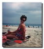 """Beach Blanket, Beach Blanket""<br /> Doris (Pinette) Hall posing on the blanket at Seabrook Beach, NH, 1975."
