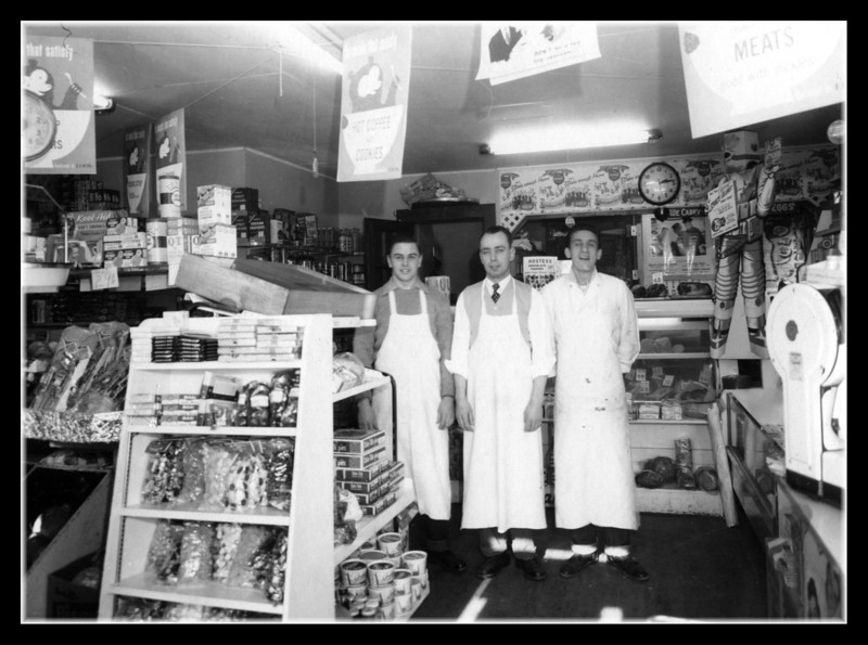 """Clermont's Market""<br /> Wilfred (Jr) Hall (right) in Clermont's Market with owner Del Clermont (center) & Richard Krawczyk (left). Do you remember the market on Lakeview Ave. next to Laura's Donut shop & Geoffroy's Pharmacy? We had a lot of fun walking through the yards behind the stores from Pepere's house to go get a treat."