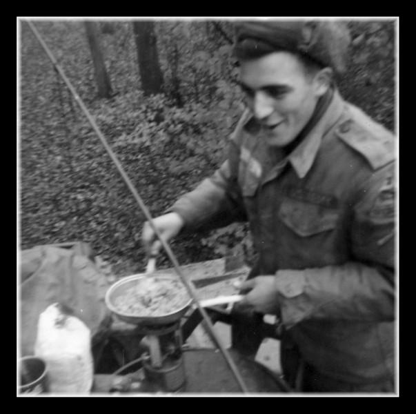 "Roger ""Butch"" Hall fixing some grub."