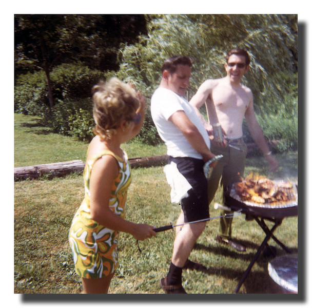 """""""Fire! Fire!""""<br /> That's Arlene Hall trying to control the """"cooks"""", Donald & Gerry Hall as the food goes up in flames at one of the Hall cookouts, 1971."""