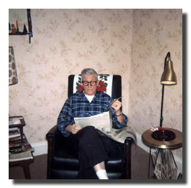 """""""Pepere""""<br /> Wilfred Hall relaxing, reading the paper."""