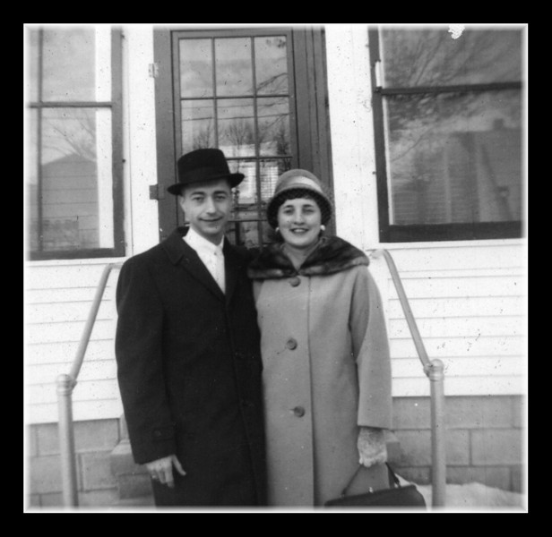 Raymond & Ruth (Hall) Asselin in front of Pepere Hall's house.