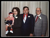 """Four Generations""<br /> Four generations of Halls gathered at Memere & Pepere Hall's 50 anniversary celebration. (l-r); Michael Jr. (first great-grandchild of Memere & Pepere Hall), Michael Sr., Wilfred Jr. & Wilfred Sr. Hall, 1977."