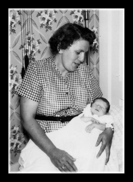 "Memere Rose (Couture) Hall & unknown baby, 1954. The back of the photo says; ""Jrs mother his godmother, 1954"". Anybody know who the baby is?"
