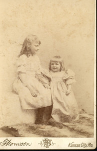 On the left, Charlotte Smiser born 1885 the daughter of Merritt Booker Smiser and Elizabeth Wilkes.  On the right, her cousin Elizabeth Azile Harrison the daughter of Robert Ferdinand Harrison and Mary Elvira Wilkes.  Elizabeth Wilkes and Mary Elvira Wilkes were sisters.