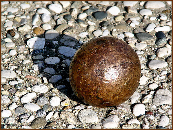 """Civil War Cannon Ball 3"""" 6 lbs Non Rifled (or smooth-bore?)<br /> <br /> Original from William Polk Gean, 28th NCT 1861-1865 to his son Walter Diggs Gean, and then to the sons of Evelyn Mae Gean Sparks.<br />  <br /> My two brothers and I have fond memories of growing up with this 6 pound hunk of bronze ... Many a young Sparks Brother's toe was nipped with this thing... then it did a fair number of Sparks Brother's Children's toes, and it's now into doing damage on the Sparks Brother's Grandchildren... so much so that the current """"Custodian of the Ball"""" (Alan Blaine Sparks) keeps it hidden, much as Evelyn did.<br /> <br /> Counting the William Polk Gean bunch, that's potentially five generations of bruised toes so far...not bad for one small Civil War cannon ball..."""