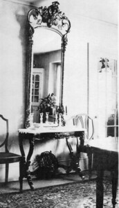 "Gilded mirror in Hill family. Passed by Gladys Hill Johnson to her son Robert Eugene Johnson. In great disrepair, disposed of after the latter's death in 1999.  Note on photo: ""End of Dining room. Dana [Hill] suggested to mother to thake the front of this mirror, paint the gold frame white, and put it in the bathroom."""