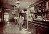 "Michael Logan (foreground, with cane), ""Schooner"" Daniel Lanahan (behind bar)."