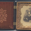 This is a picture of an unknown woman that is housed in a beautiful wooden case.  The style of case is shown here.  The very first very faded image of an unknown male was found behind the velvet batting on the left side of this case.  We assume she may be a member of the family as it was found in LA Hull's trunk with other family history type information; ie photos of others we knew, obituaries, school papers, deeds etc.