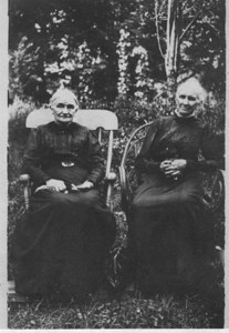 """There is a second photo in the album of  Jane Bertha (Rogers) Iddings and her sister Hannah (Rogers) Thompson. The writing on the back of the photo says """"Rogers Uriah girls. lst cousins of Permilla Rogers Meredith.  Mrs. Iddings left Warry's mother.  Mrs. Thompson right George's mother.  They were sisters.""""   The """"George"""" according to Ed Dew's database is George McCleland Thompson the son of Peter Thompson and Hannah Rogers.  That makes the woman on the right Hannah (Rogers) Thompson.  The Permilla Rogers Meredith referred to is Permilla Alvira Rogers, Joseph's daughter.  She married James Reasman Meredith."""