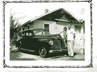 Back of photo says, James,  Beverly and new car at home.  1941 House on Martha,  Dodge car