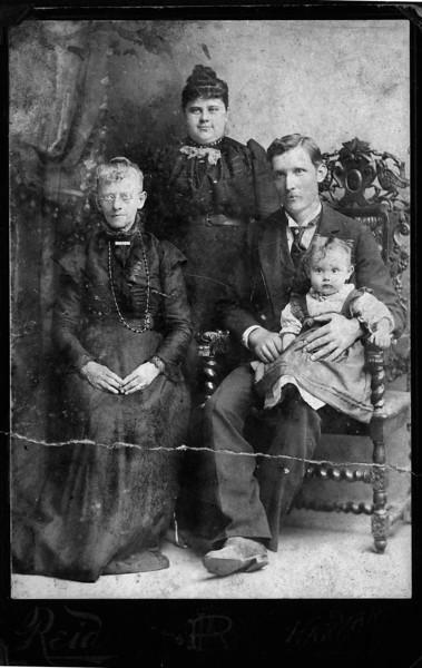 Emily Jane (Sickles) Ellis, Emily Lucinda (Ellis) and Charles Louis Johnson with baby