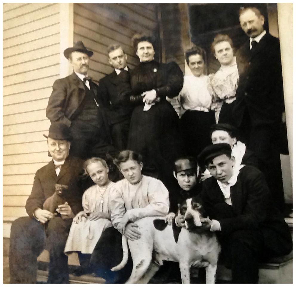 1900 Standing L-R: Arthur Ewald Krebs, Stanley Edward Krebs, Mary Amanda (Oma) Krebs, Emma (Stanley) Krebs (known also as Genny), Emma (Rutz) Krebs, Charles Frederick (Karl) Krebs Seated L-R:  Otto A. Krebs (Opa), Doris Althalia Krebs, Virgina Krebs, Otto St. Clair Krebs Jr., Waldo K. Krebs, Wilbur (Wib) Edward Krebs (behind Waldo) and Jap, the dog!