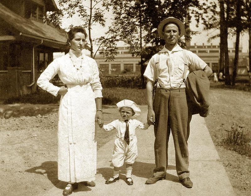 Mother Maria (Fusi) Lombardi, Guido (Guy) , and Father Giuseppe (Joe) Lombardi. Circa 1916. In front of their home that Joe built by hand. In the background is the Buick Motor Co. where Joe worked as a Hammer (forged parts) man. Flint.
