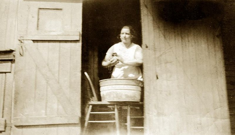 "Maria (Fusi) Lombardi and her ""washing machine"". ca. 1919."