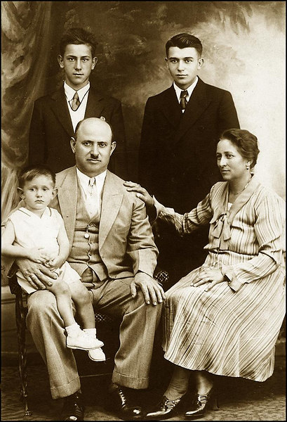 Lombardi Family photo taken at Smart Studio in Hamtramch, Mi., 1932. Before everyone (but Guy) left for Italy in 1933. From L to R: Front: Mario, Guiseppe, Luigia. Back: Modesto, Guy Lombardi.
