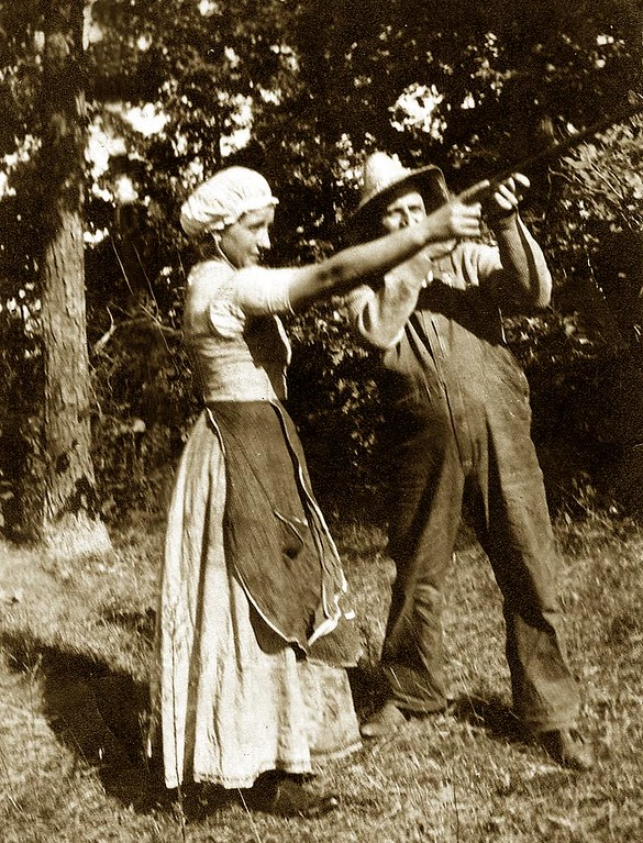 "Maria (Fusi) Lombardi & Husband Giuseppe ""Joe"" Lombardi aiming Stevens 12 guage, Model No. 85, <i>'Dreadnaught'</i>. Milford, 1916"