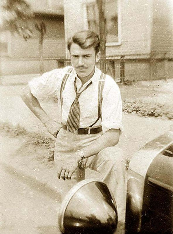 Guy Lombardi Sr., circa 1935, with his 1929 Chevy two door sedan, formaly a company car that was used by the superintendent of Chevy Forge Plant. The  car later was traded in as a $125.00 credit on a 1936 Chevy two door sedan for $650.00 new.<br /> <br /> The 1929 Chevy two door sedan had a tendency to break the rear axle shaft every 10,000 miles. Guy personally replaced three rear axle shafts on this car.